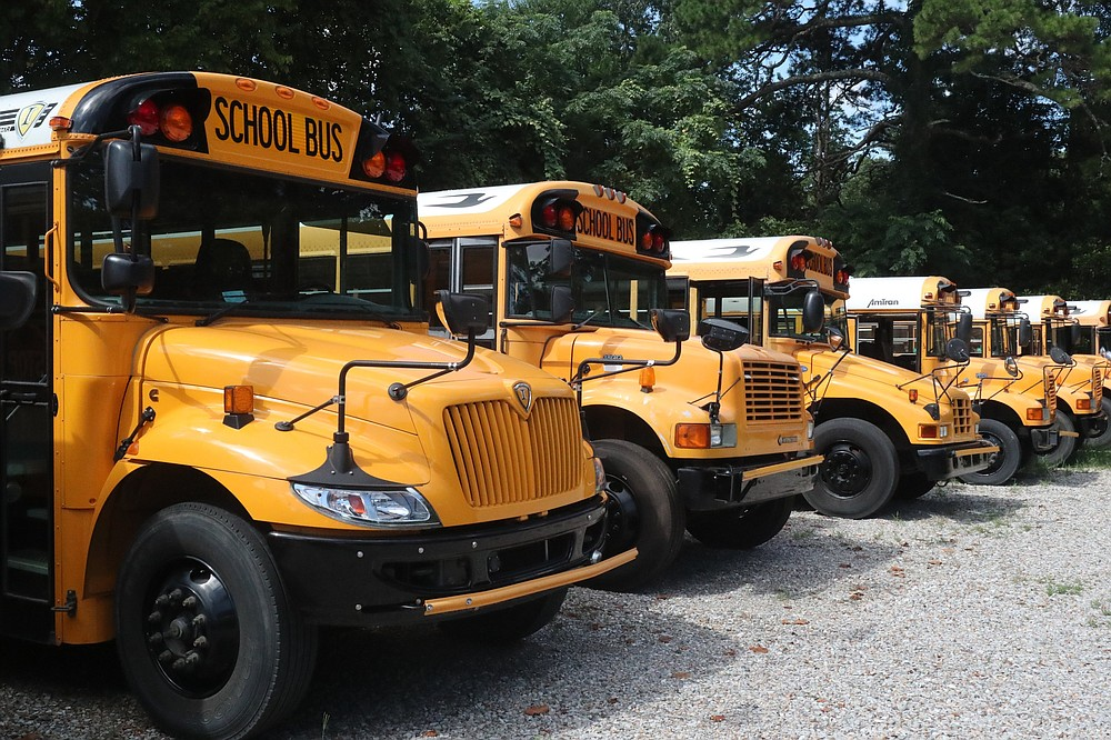 Hot Springs School District buses. - File photo by Richard Rasmussen of The Sentinel-Record