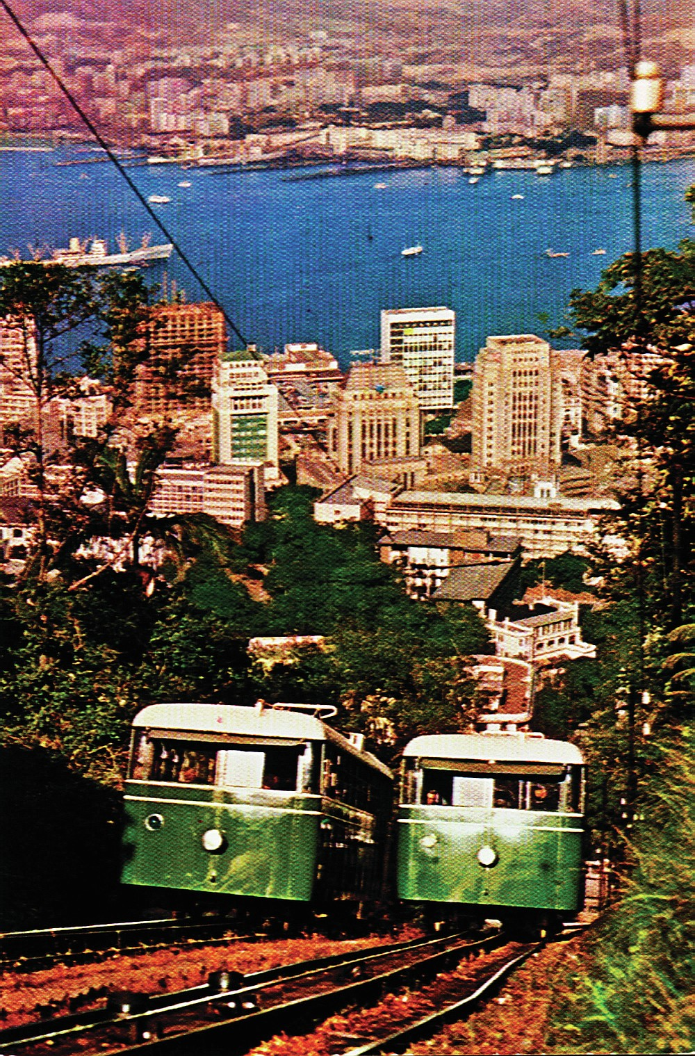 In this undated photo provided by Hong Kong Peak Tramways, a 3rd generation Peak Tram which serviced from 1948-1959 is seen in Hong Kong. The Peak Tram started operations in 1888, when Hong Kong was a British colony, to transport people up Victoria Peak instead of using sedan chairs. The original carriages were made of varnished timber and seated 30 passengers in three classes. (Hong Kong Peak Tramways via AP)