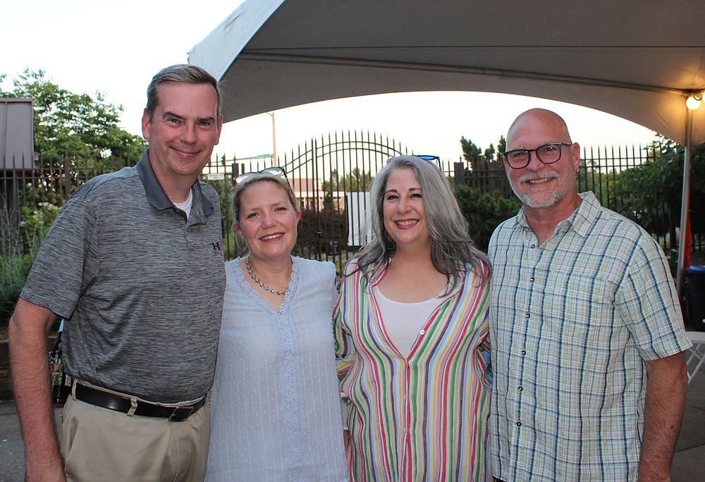 Scott and Kyla Price (from left) and Kelly and Scott Syer gather at Red, White and Baby Blue.  (NWA Democrat-Gazette/Carin Schoppmeyer)