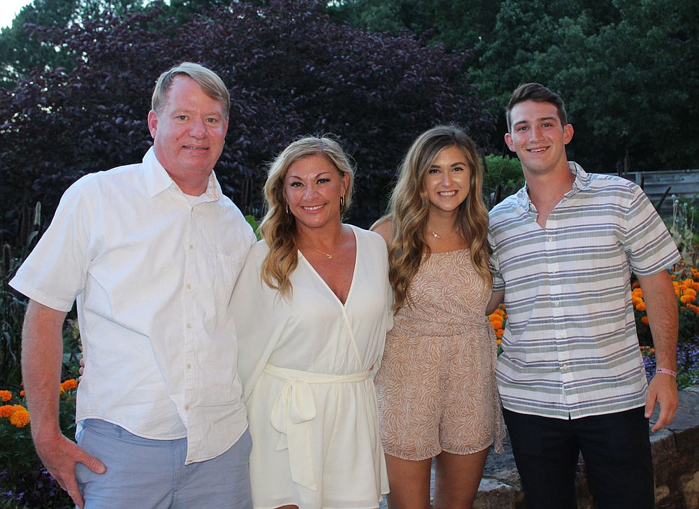 Clay and Juli McWhorter (from left) and Ashlyn Babbitt and Colin McWhorter gather at Red, White and Baby Blue. (NWA Democrat-Gazette/Carin Schoppmeyer)