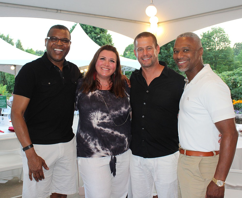 Jerry Jackson (from left), Kristin and Lee Evans and Marcus Pinkey attend Red, White and Baby Blue. (NWA Democrat-Gazette/Carin Schoppmeyer)