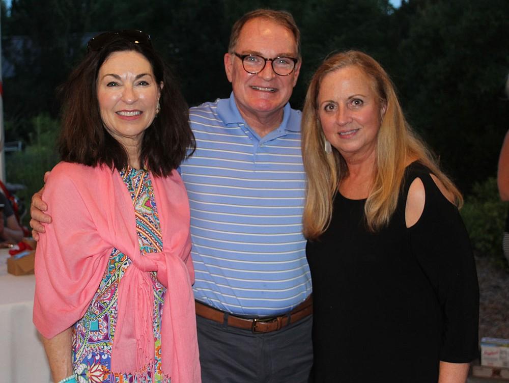 Kathryn and Bill Warren (from left) visit with Debbie Ogg at Red, White and Baby Blue. (NWA Democrat-Gazette/Carin Schoppmeyer)