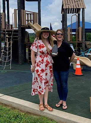 Zoe Naylor (left), Rotary Club of Fayetteville for 2020-21, is presented an honorary Service Above Self award by Kelly Gemmell, Service Above Self committee member, at the group's 100th anniversary and Service Above Self Picnic June 5.