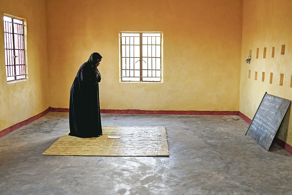 Lucy Mbewe, a traditional birth attendant prays, in a Mosque before attending to pregnant women, in Simika Village, Chiradzulu, southern Malawi, Sunday, May 23, 2021. Health officials in Malawi say fewer women are getting prenatal care amid the COVID-19 pandemic. At risk are the developing country's gains on its poor rate of maternal deaths. (AP Photo/Thoko Chikondi)
