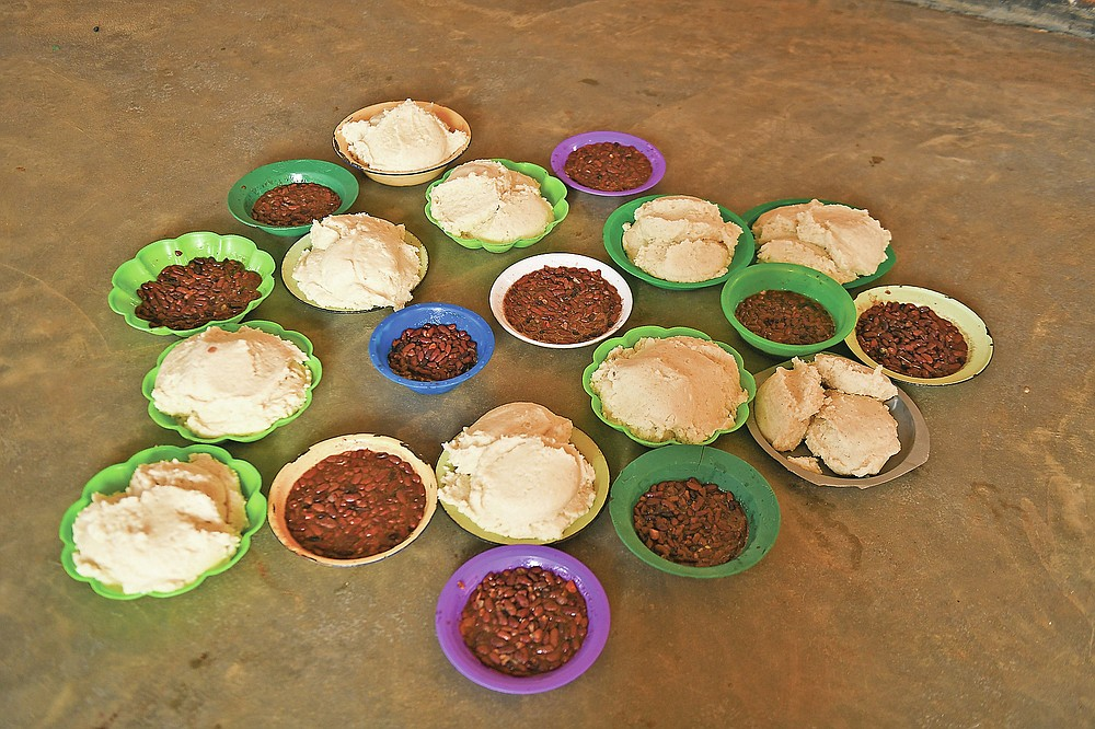 Plates of food provided by Lucy Mbewe, a traditional birth attendant for pregnant women, at her home in Simika Village, Chiradzulu, southern Malawi on Sunday, May, 2021. Health officials in Malawi say fewer women are getting prenatal care amid the COVID-19 pandemic. At risk are the developing country's gains on its poor rate of maternal deaths. (AP Photo/Thoko Chikondi)