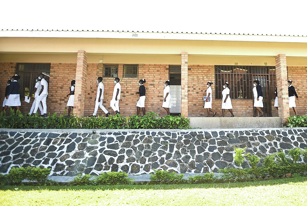 Nursing and midwifery students walk, at St Joseph College of Nursing and Midwifery, in Chiradzulu, southern Malawi on Friday, May, 28, 2021. Health officials in Malawi say fewer women are getting prenatal care amid the COVID-19 pandemic. At risk are the developing country's gains on its poor rate of maternal deaths. (AP Photo/Thoko Chikondi)