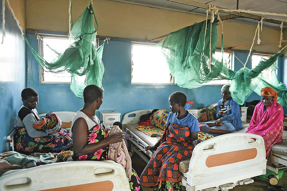 Women sit in a postnatal ward at Malawi Government's Mauwa Health Centre labour ward, in Chiradzulu southern Malawi on Wednesday, May 26, 2021. Health officials in Malawi say fewer women are getting prenatal care amid the COVID-19 pandemic. At risk are the developing country's gains on its poor rate of maternal deaths. (AP Photo/Thoko Chikondi)