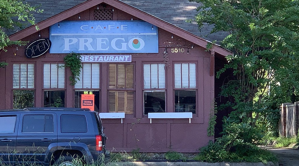 An orange placard notifies passers by that the city of Little Rock has received a rezoning application for the former Cafe Prego on Kavanaugh Boulevard in Pulaski Heights. (Arkansas Democrat-Gazette/Eric E. Harrison)