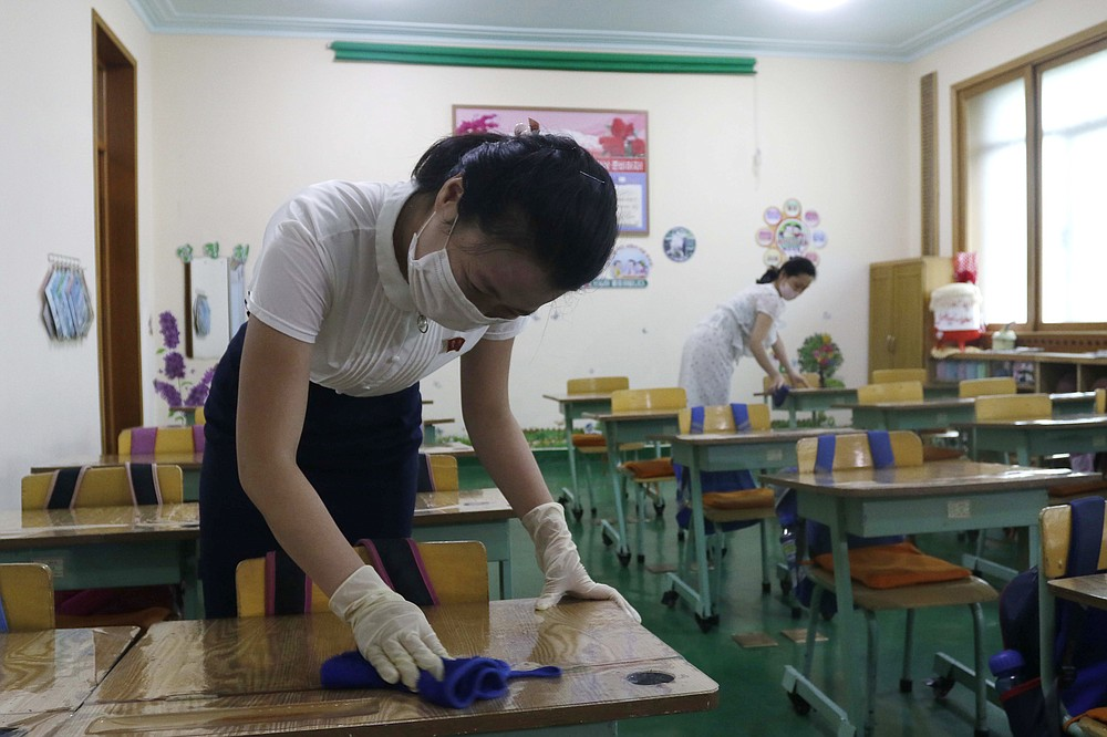 Staff at Pyongyang No.4 Primary School clean desks in classrooms in Pyongyang, North Korea on Wednesday, June 30, 2021. North Korean leader Kim Jong Un berated senior officials for failures in prevention of coronaviruses that have caused