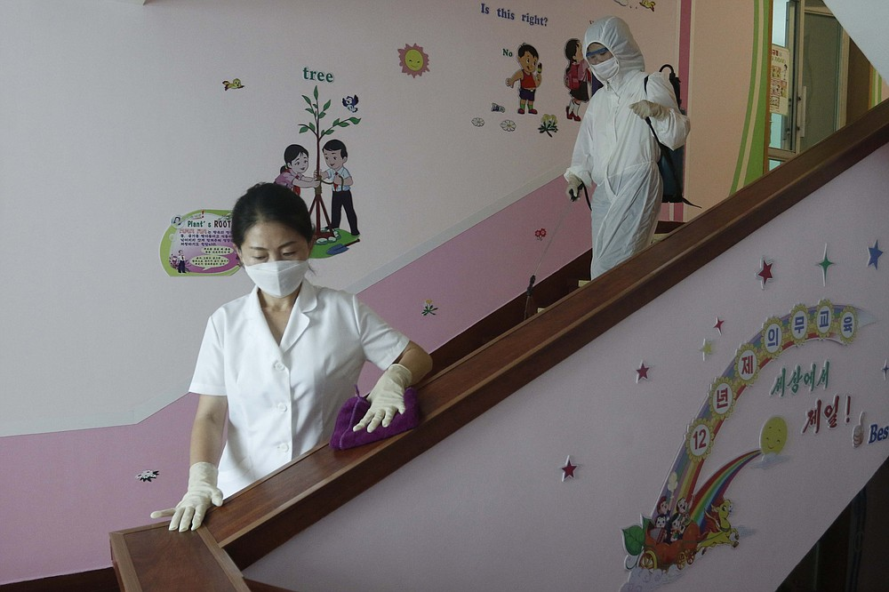 Staff at Pyongyang No.4 Primary School clean the stairwells in Pyongyang, North Korea on Wednesday, June 30, 2021. North Korean leader Kim Jong Un berated senior officials for the failures of the prevention of coronaviruses that have caused
