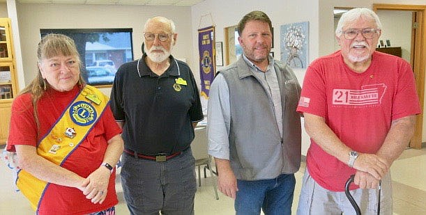 Westside Eagle Observer/SUSAN HOLLAND 2021-2022 officers of the Gravette Lions Club pose just after their installation ceremony Tuesday, July 6, at the Billy V. Hall Senior Activity Center. Pictured are Linda Damron, president; Jeff Davis, secretary/treasurer; Mayor Kurt Maddox, installing officer; and Bill Mattler Sr., tail twister/Lion tamer. Vice-president Cela Gaytan was not present and will be installed at a later date.