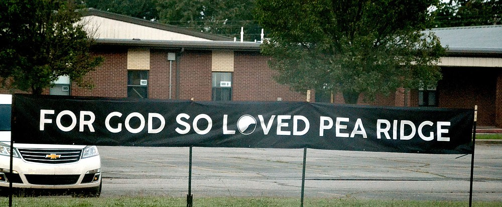 On the front lawn of Pea Ridge Junior High (Ark. Hwy. 94/West Pickens Road), a sign greets people entering town off Hayden Road, a reminder of the tragedy this week that took the life of a city police officer.