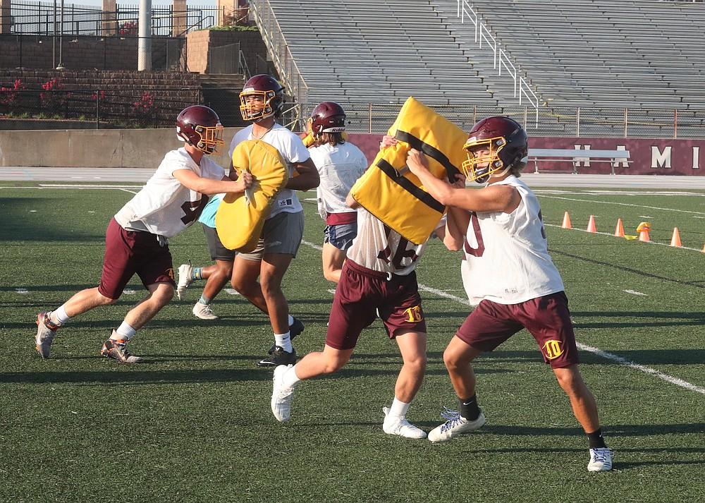 Lake Hamilton High School football players practice. File photo by Richard Rasmussen of The Sentinel-Record