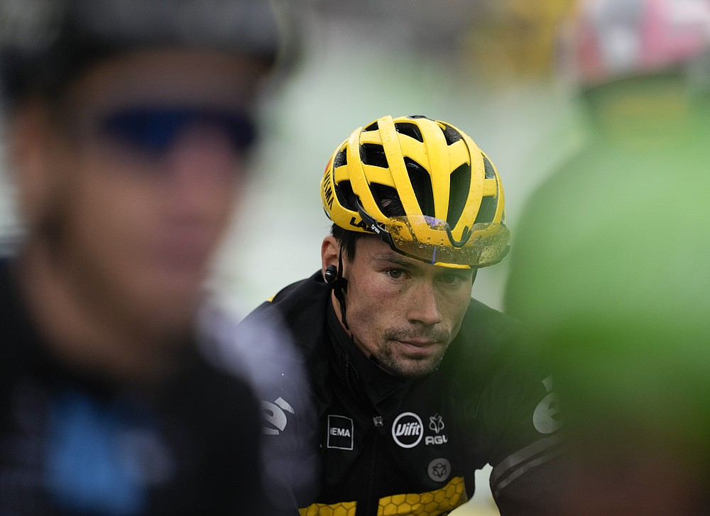 Slovenia's Primoz Roglic arrives at the finish of the eighth stage of the Tour de France cycling race over 150.8 kilometers (93.7 miles) with start in Oyonnax and finish in Le Grand-Bornand, France,Saturday, July 3, 2021. (AP Photo/Daniel Cole)