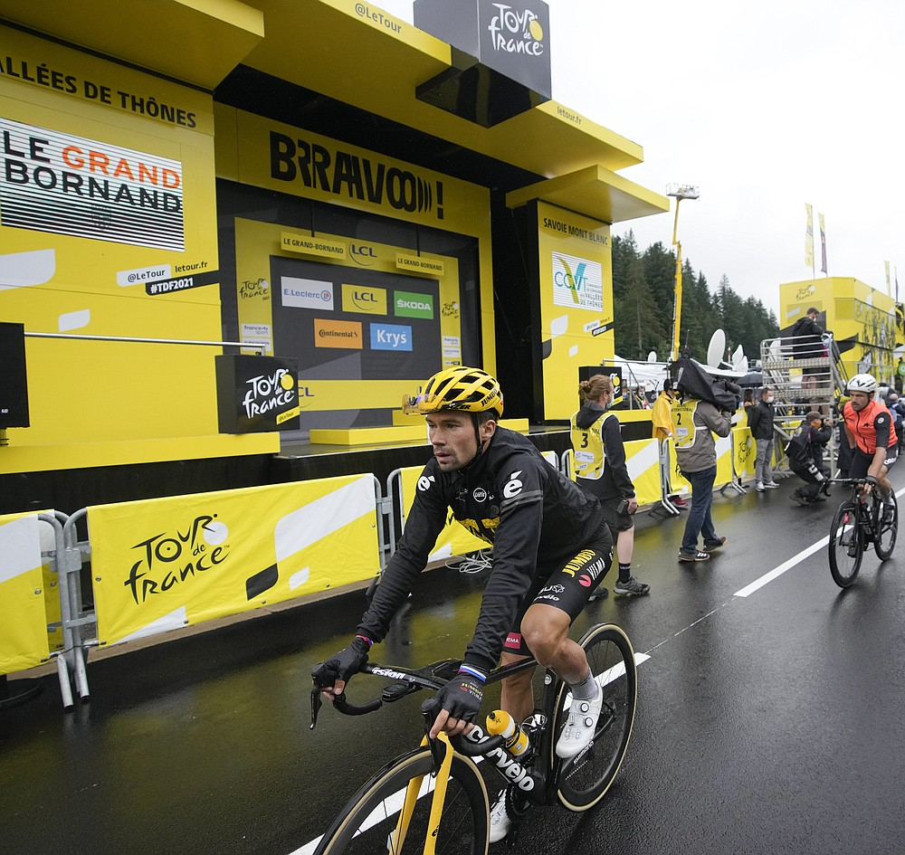 Slovenia's Primoz Roglic passes an empty podium after losing considerable time in the eighth stage of the Tour de France cycling race over 150.8 kilometers (93.7 miles) with start in Oyonnax and finish in Le Grand-Bornand, France,Saturday, July 3, 2021. (AP Photo/Christophe Ena)