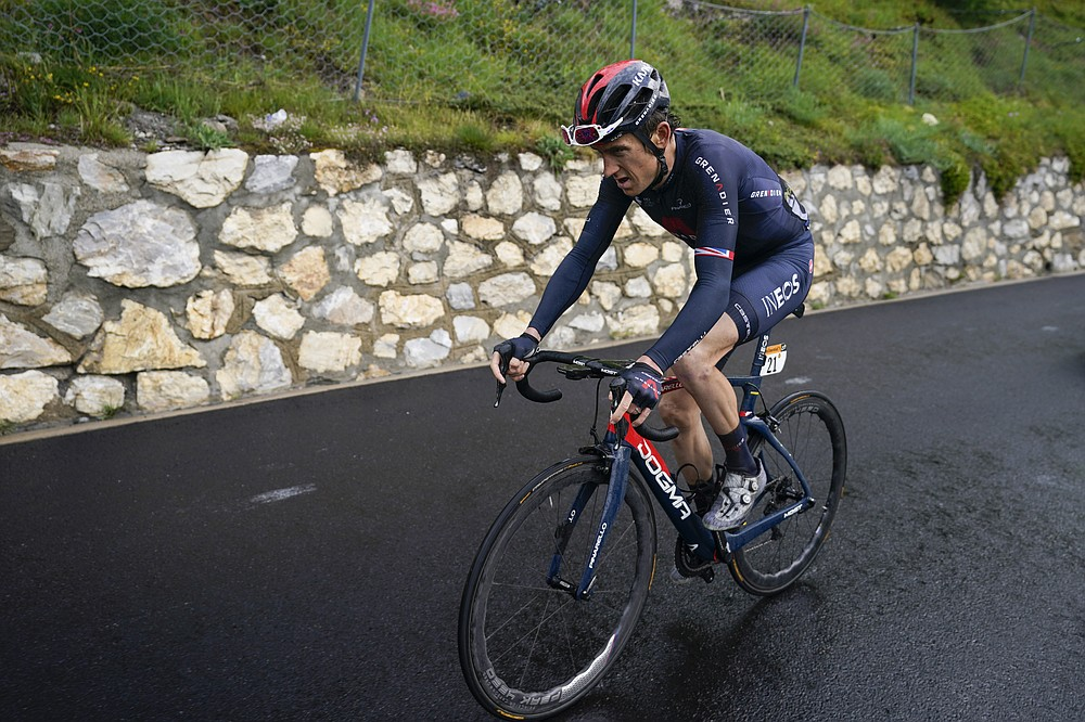 Britain's Geraint Thomas is distanced by overall leader Slovenia's Tadej Pogacar as he climbs towards Tignes during the ninth stage of the Tour de France cycling race over 144.9 kilometers (90 miles) with start in Cluses and finish in Tignes, France, Sunday, July 4, 2021. (AP Photo/Daniel Cole)