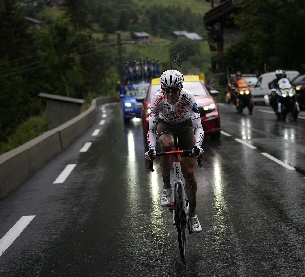 Stage winner Australia's Ben O'Connor leads as he climbs towards Tignes during the ninth stage of the Tour de France cycling race over 144.9 kilometers (90 miles) with start in Cluses and finish in Tignes, France, Sunday, July 4, 2021. (AP Photo/Daniel Cole)