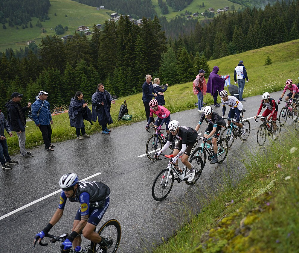 Stage winner Australia's Ben O'Connor, in second position, follows Italy's Mattia Cattaneo, during the ninth stage of the Tour de France cycling race over 144.9 kilometers (90 miles) with start in Cluses and finish in Tignes, France, Sunday, July 4, 2021. (AP Photo/Daniel Cole)