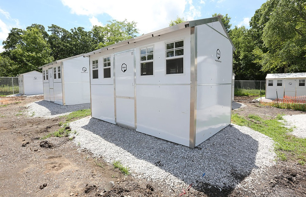 Construction continues Tuesday, June 29, 2021, on new cabins at New Beginnings located south of 19th Street and South School Avenue in Fayetteville. The plans for New Beginnings involve 20 prefabricated houses with about 140 square feet of living space, with a 2,800-square-foot community building to provide clients basic needs. Check out nwaonline.com/210704Daily/ and nwadg.com/photos for a photo gallery. (NWA Democrat-Gazette/David Gottschalk)
