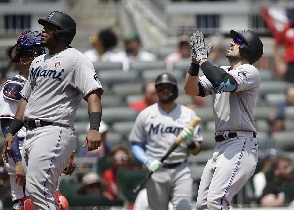 Miami Marlins 'Adam Duvall, right, celebrates after hitting a three-run homerun against Atlanta Braves' Charlie Morton in the sixth inning of a baseball game on Sunday, July 4, 2021 in Atlanta.  (AP Photo / Ben Margot)