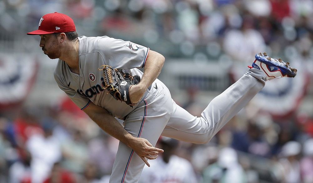 Miami Marlins pitcher Zach Thompson faces the Atlanta Braves in the first inning of a baseball game on Sunday, July 4, 2021 in Atlanta.  (AP Photo / Ben Margot)