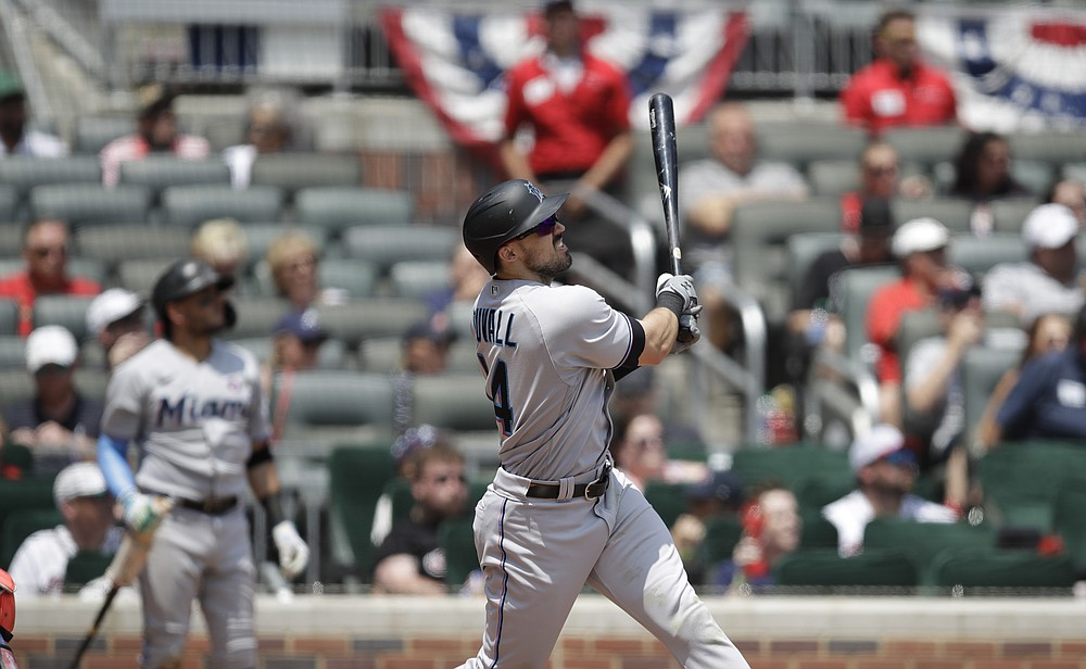 Miami Marlins Adam Duvall watches his three-runner home run hit Charlie Morton of the Atlanta Braves in the sixth inning of a baseball game on Sunday, July 4, 2021 in Atlanta.  (AP Photo / Ben Margot)