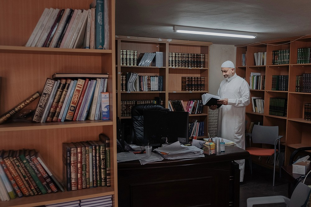 Sheikh Raed Bader, a follower and spiritual successor of Sheikh Abdullah, at his office in Kafr Qasim, Israel on June 26, 2021. Bader, one of Sheikh Abdullah Nimr Darwish's spiritual successors, who are fighting to restore momentum to a formal peace process that petered out in 2014. The inclusion of an Islamist party in Israel's government has spurred a group of imams and rabbis hoping to build a religious-based peace movement. (Amit Elkayam/The New York Times)