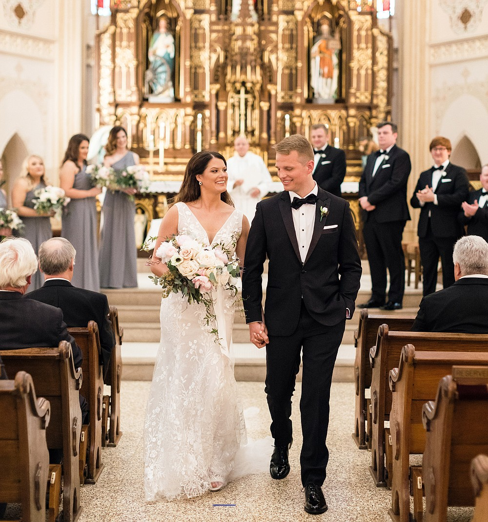 Reagan and Cody Timmermann married on April 24, 2021, at St. Edward Catholic Church with vaccinated family and friends in attendance and masks available for everyone. (Special to the Democrat-Gazette/Lela and Lyla)