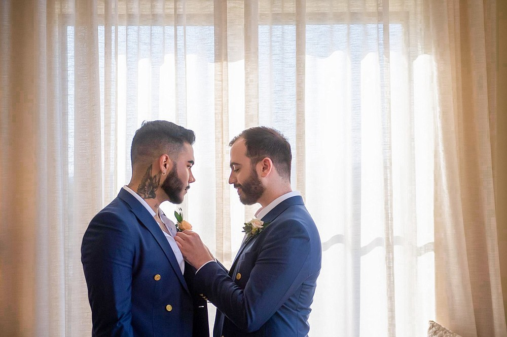 Michael DeSalvo Solarte (left) and his husband Alejandro Solarte DeSalvo share a moment June 25 before their ceremony. The couple had postponed plans to marry until 2022 but won a trip to be married at Carneros Resort and Spa in California's Napa Valley through the nonprofit Visit California. (Special to the Democrat-Gazette/Max Whittaker)