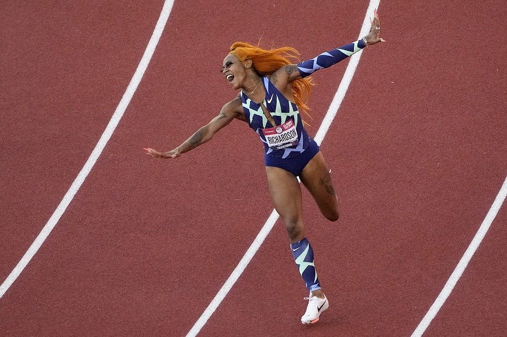 Sha'Carri Richardson celebrates after winning the women's 100-meter at the United States Olympic Track and Field Trials on Saturday, June 19, 2021 in Eugene, Ore. (AP Photo / Charlie Riedel)