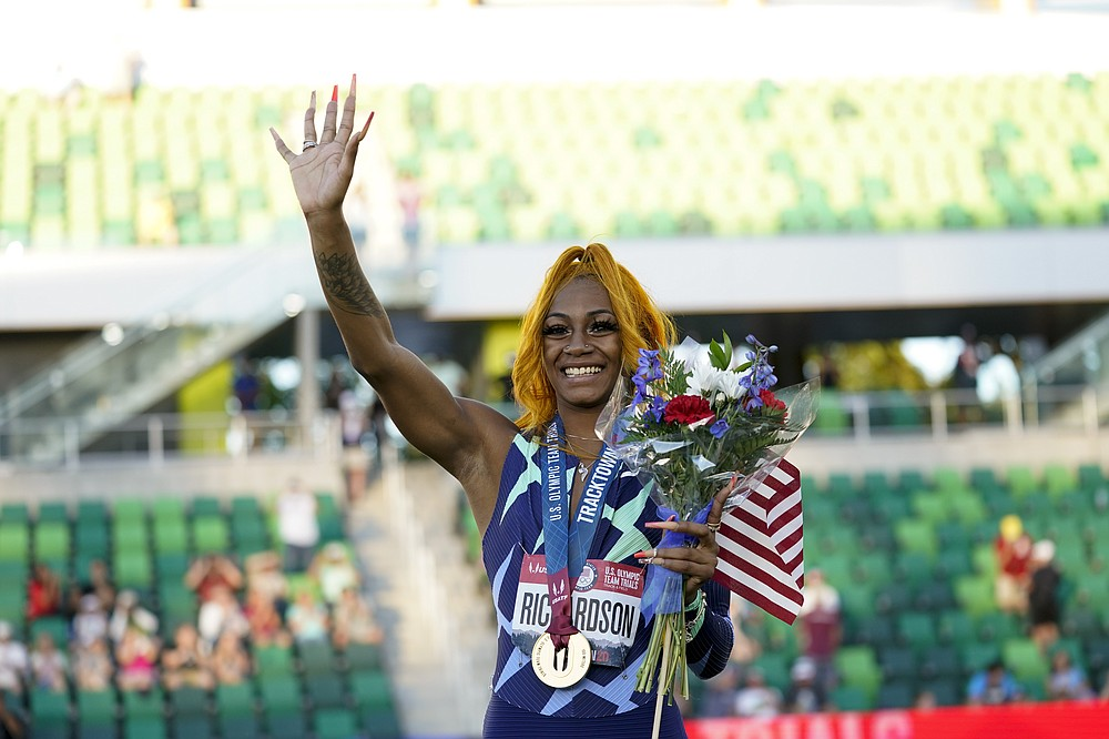 Sha'Carri Richardson salutes after winning the women's 100-meter at the United States Olympic Track and Field Trials on Saturday, June 19, 2021 in Eugene, Ore. (AP Photo / Ashley Landis)