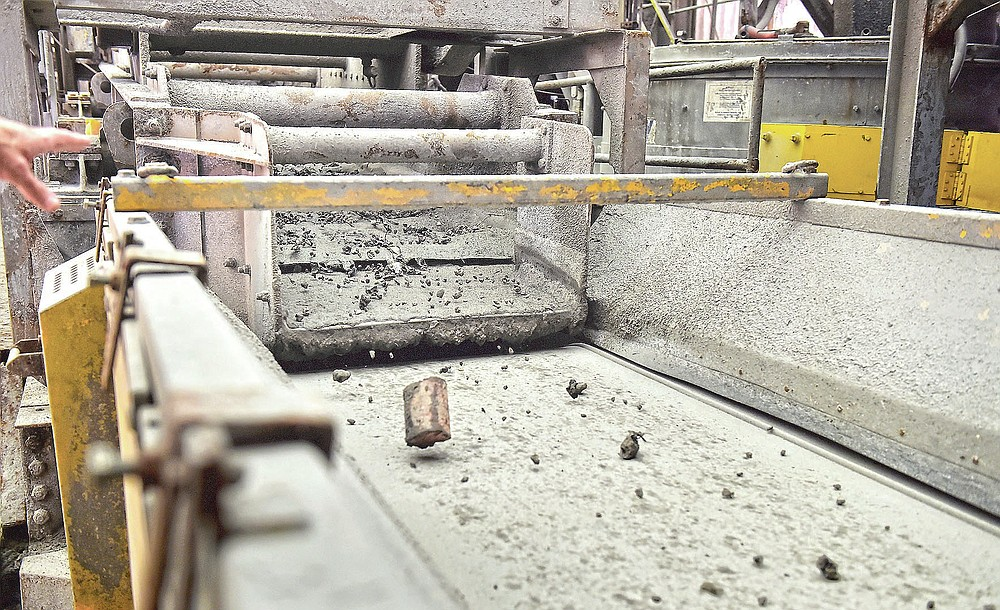 Ash, cans, metal and other debris moves on a conveyor belt after a cool down period during a tour of the Lancaster County Solid Waste Management Authority's waste-to-energy facility in Bainbridge, Pa., Wednesday, June 16, 2021.  (Suzette Wenger/LNP/LancasterOnline via AP)