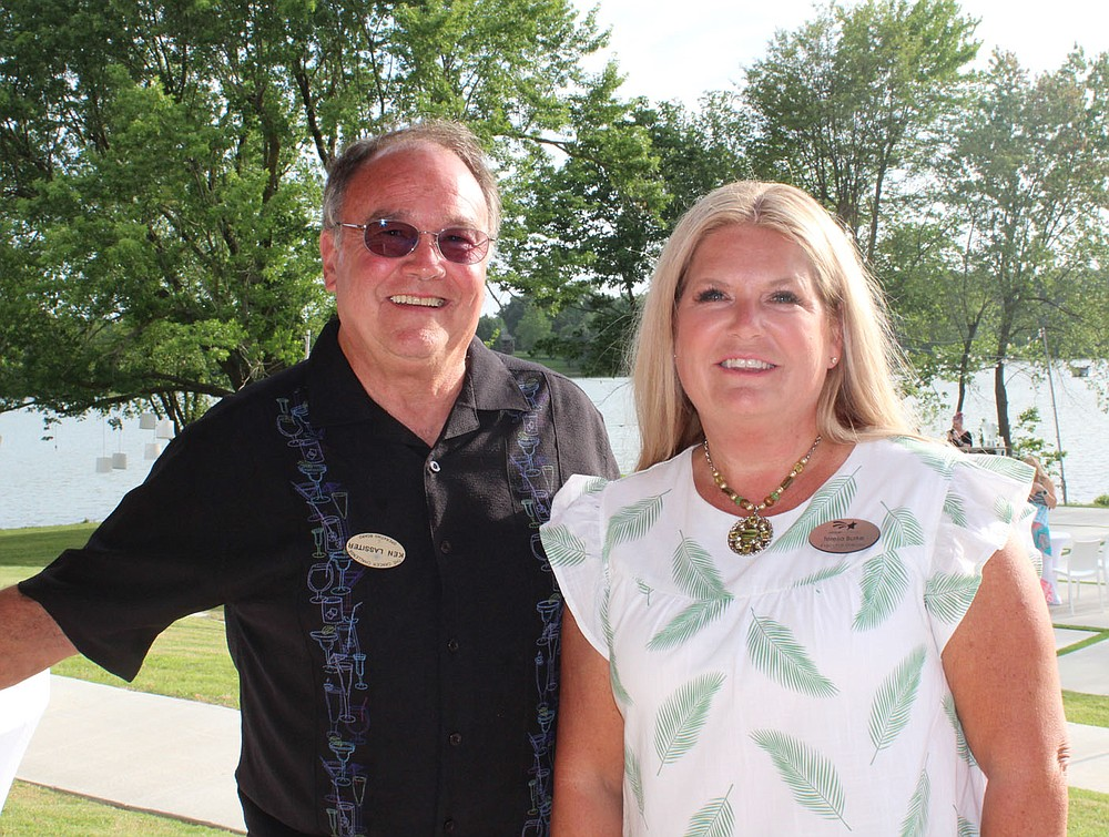 Ken Lassiter, Cancer Challenge Hidden Hero honoree, and Teresa Burke stand for a photo at the Summer Soiree. (NWA Democrat-Gazette/Carin Schoppmeyer)