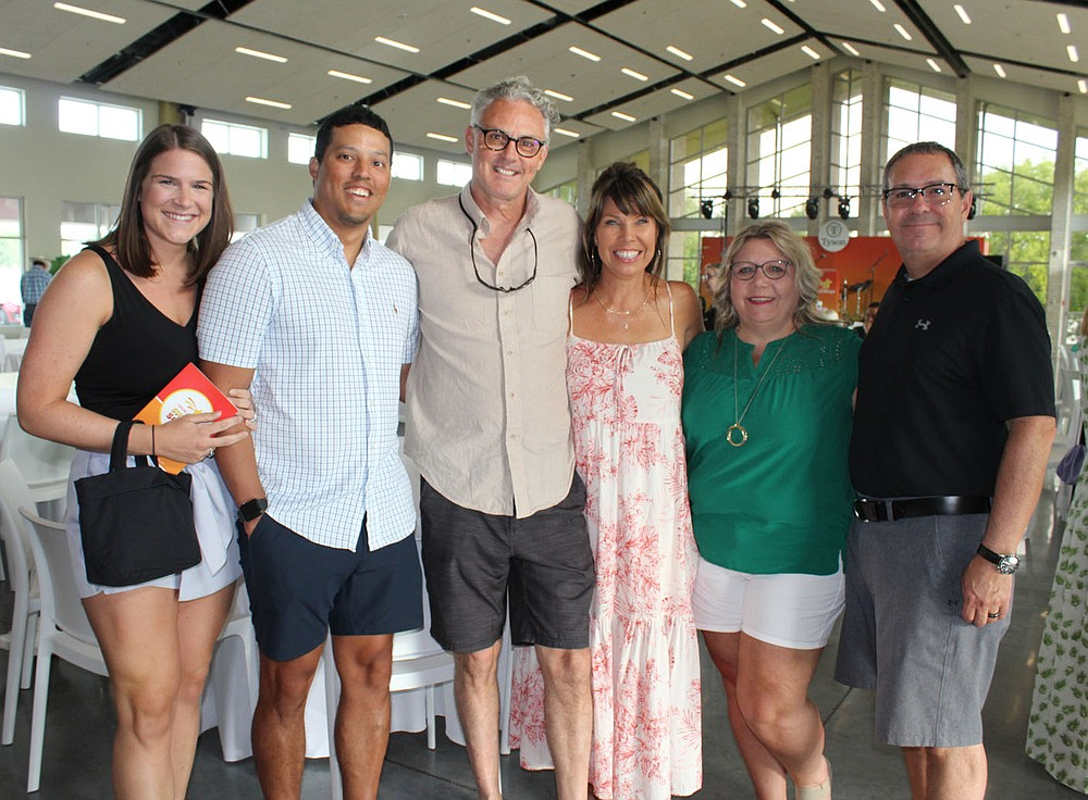 Hannah and Sergio Hernandez (from left), Jim and Christi Gallagher and Cherie and Jeff Seyfarth enjoy the Cancer Challenge social. (NWA Democrat-Gazette/Carin Schoppmeyer)