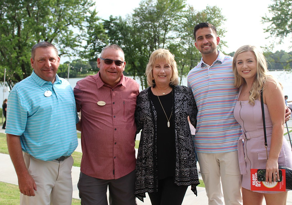 Gran Callahan (from left), Craig and Gail Powers and Luke Vera and Sophia Roehl gather at the Summer Soiree. (NWA Democrat-Gazette/Carin Schoppmeyer)