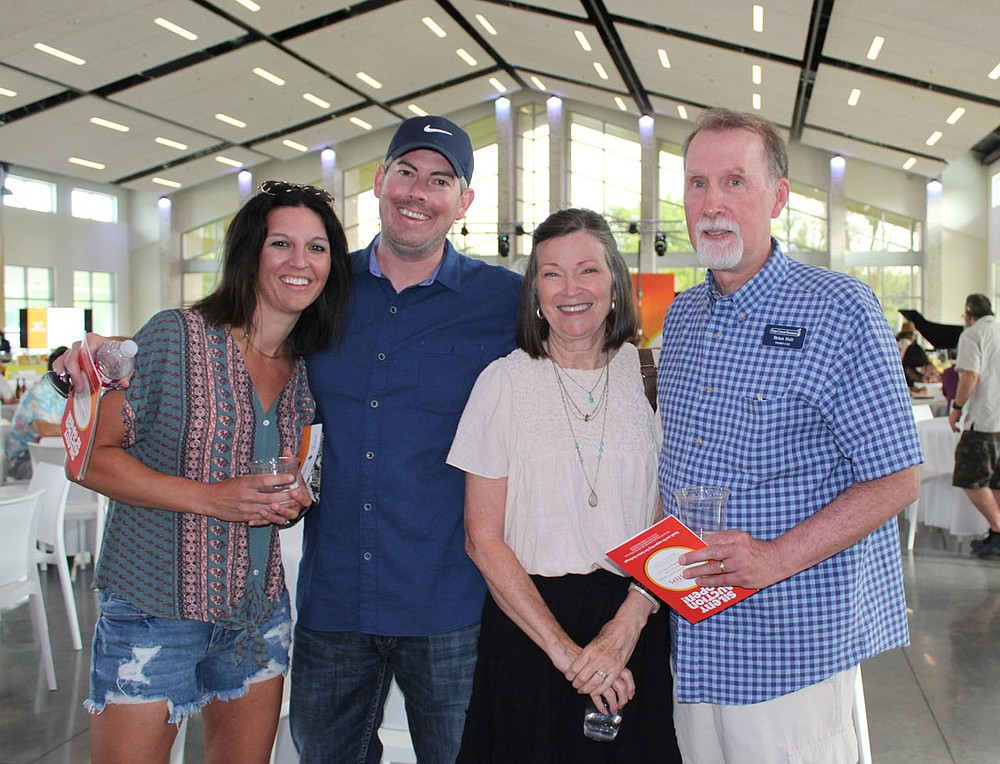 Chere and Brandon Skinner (from left) and Debbie and Brian Holt visit at the Summer Soiree. (NWA Democrat-Gazette/Carin Schoppmeyer)