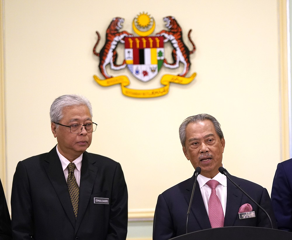 In this Wednesday, May 11, 2020, photo, Malaysia's Prime Minister Muhyiddin Yassin, right, and Defense Minister Ismail Sabri Yaakob attend a press conference in the Prime Minister's office in Putrajaya, Malaysia. Muhyiddin has appointed Ismail as his deputy, in a calculated bid to dissuade the party from withdrawing support for his leadership. (AP Photo/Vincent Thian)
