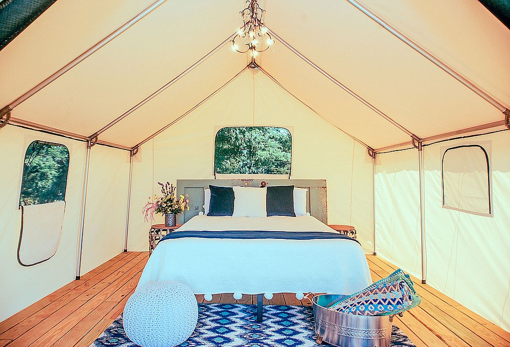 PHOTO COURTESY OF SUNSHINE JOY/Each safari tent includes detailed touches such as rugs, additional seating and side tables. If there's anything extra a guest desires, Reishus is happy to assist.