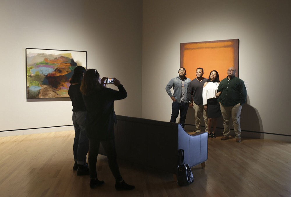 Attendees take pictures in the contemporary art gallery, Sunday, June 27, 2021 at Crystal Bridges Museum of American Art in Bentonville. Check out nwaonline.com/210711Daily/ for today's photo gallery.  (NWA Democrat-Gazette/Charlie Kaijo)