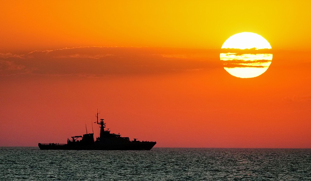 """A view of the Britain's Royal Navy patrol ship OPV """"Trent"""" in the Black Sea, Thursday late, July 8, 2021 during Sea Breeze 2021 maneuvers. Ukraine and NATO have conducted Black Sea drills involving dozens of warships in a two-week show of their strong defense ties and capability following a confrontation between Russia's military forces and a British destroyer off Crimea last month. (AP Photo/Efrem Lukatsky)"""