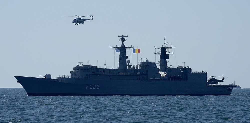 """Romanian frigate """"Regina Maria takes part in Sea Breeze 2021  maneuvers, in the Black Sea, Friday, July 9, 2021. Ukraine and NATO have conducted Black Sea drills involving dozens of warships in a show of strong defense ties amid the heightened tensions in the wake of last month's incident with a British destroyer off Crimea. (AP Photo/Efrem Lukatsky)"""