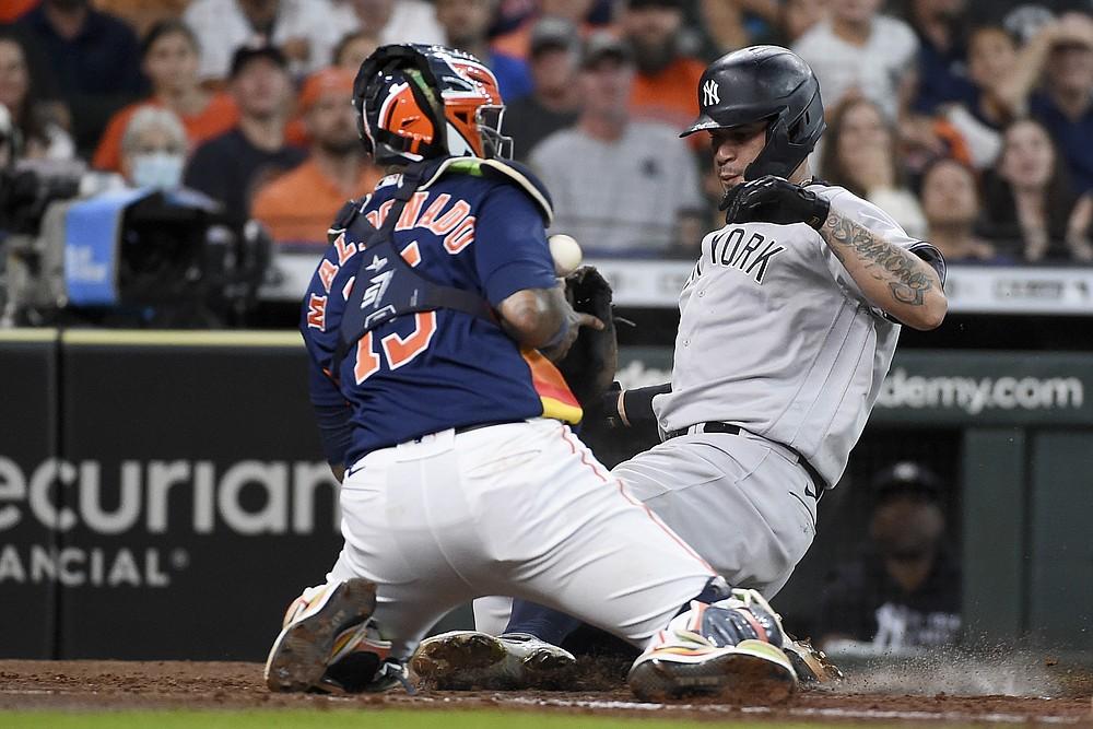 New York Yankees' Gary Sanchez, right, slides safely past Houston Astros catcher Martin Maldonado during the third inning of a baseball game, Sunday, July 11, 2021, in Houston. (AP Photo/Eric Christian Smith)