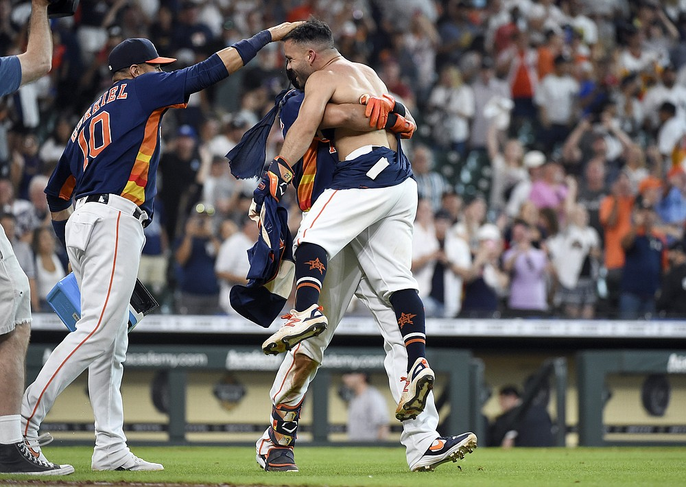 Houston Astros' Jose Altuve, right, celebrates his winning three-run home run with Yuli Gurriel, left, and Michael Brantley during the ninth inning of a baseball game against the New York Yankees, Sunday, July 11, 2021, in Houston. (AP Photo/Eric Christian Smith)