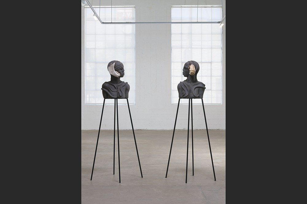 """The sculpture """"I Am Speaking, Can You Hear Me?"""" features two busts adorned all over with stylized scarification marks. (Courtesy of Wangechi Mutu and Vielmetter Los Angeles/Robert Wedemeyer)"""