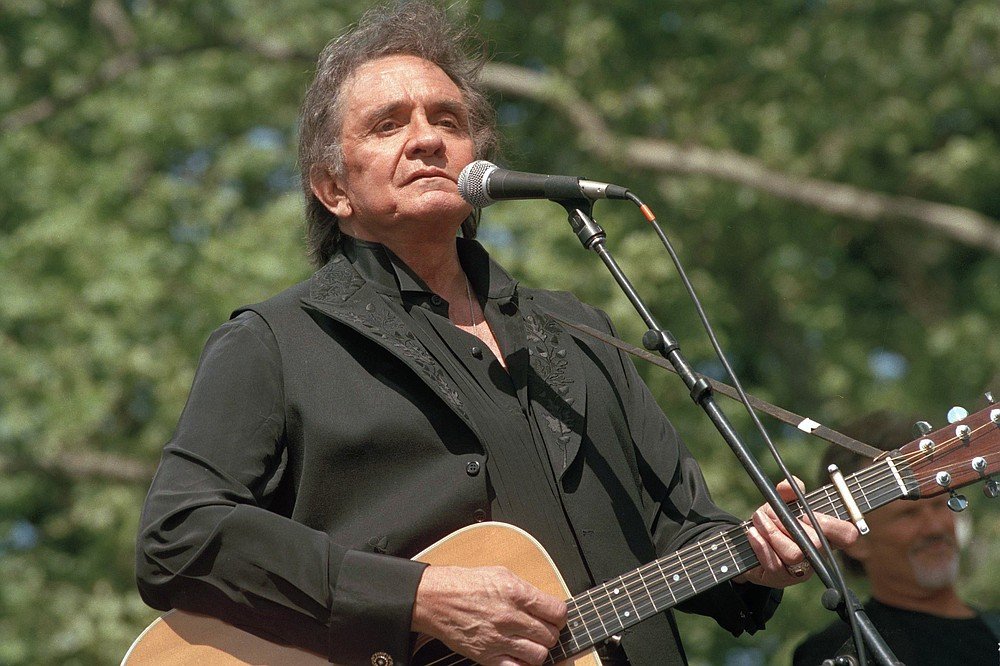 Country legend Johnny Cash performs on May 23, 1993, at a benefit concert at Central Park in New York. Cash died Sept. 12, 2003. (AP file photo)