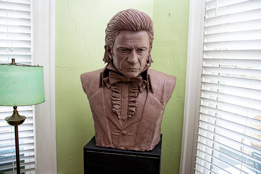 A life-size clay bust of Johnny Cash is one of three Cash likenesses adorning the home of Kevin Kresse. Kresse is creating a statue of Cash for inclusion in the U.S. Capitol. For Kresse, a Natural State artist and a Cash fan, it's the dream of a lifetime. (Arkansas Democrat-Gazette/Cary Jenkins)