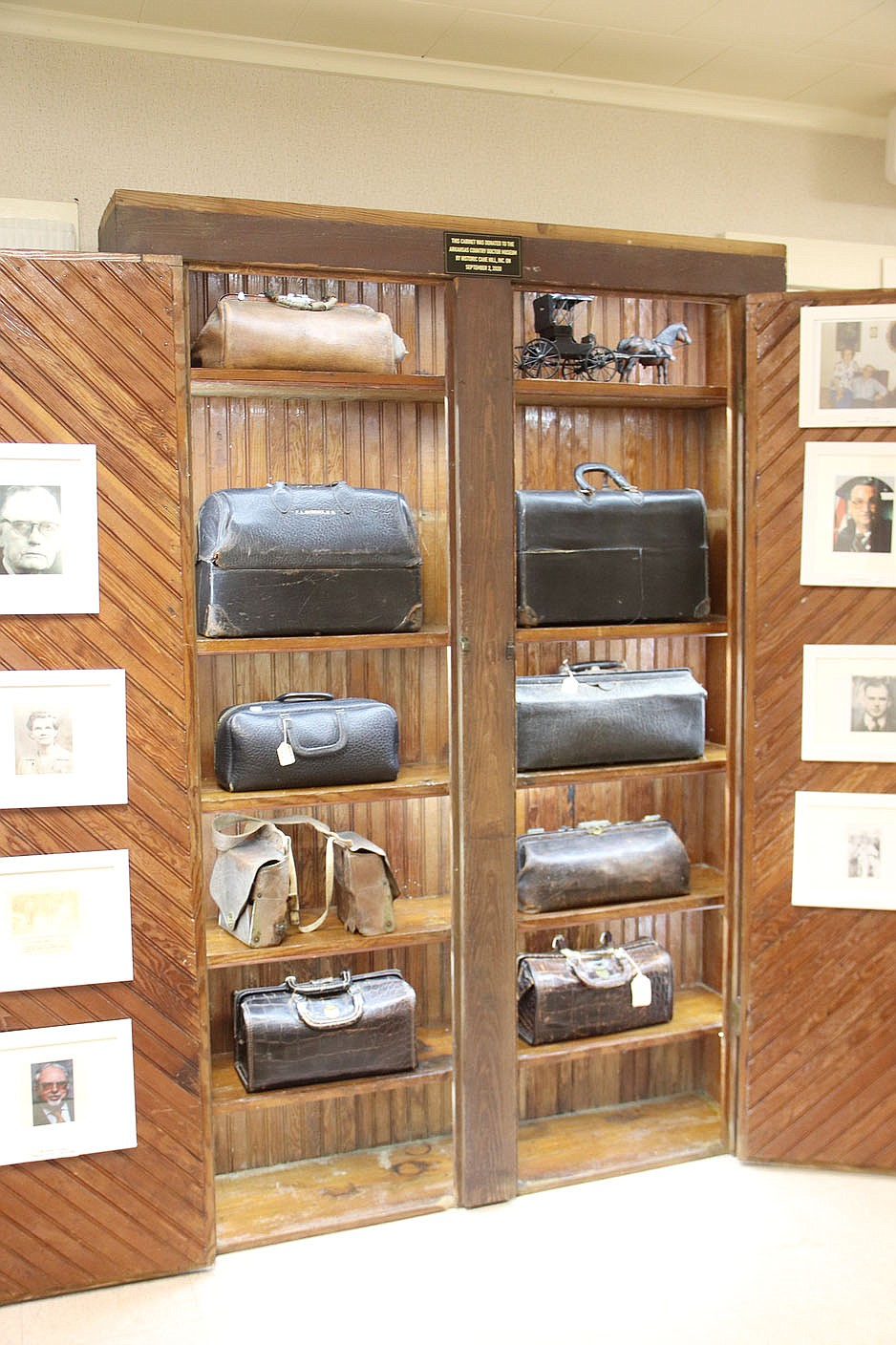 LYNN KUTTER ENTERPRISE-LEADER One of the new exhibits at the Arkansas Country Doctor Museum in Lincoln is this cabinet that displays doctors' bags of country doctors.