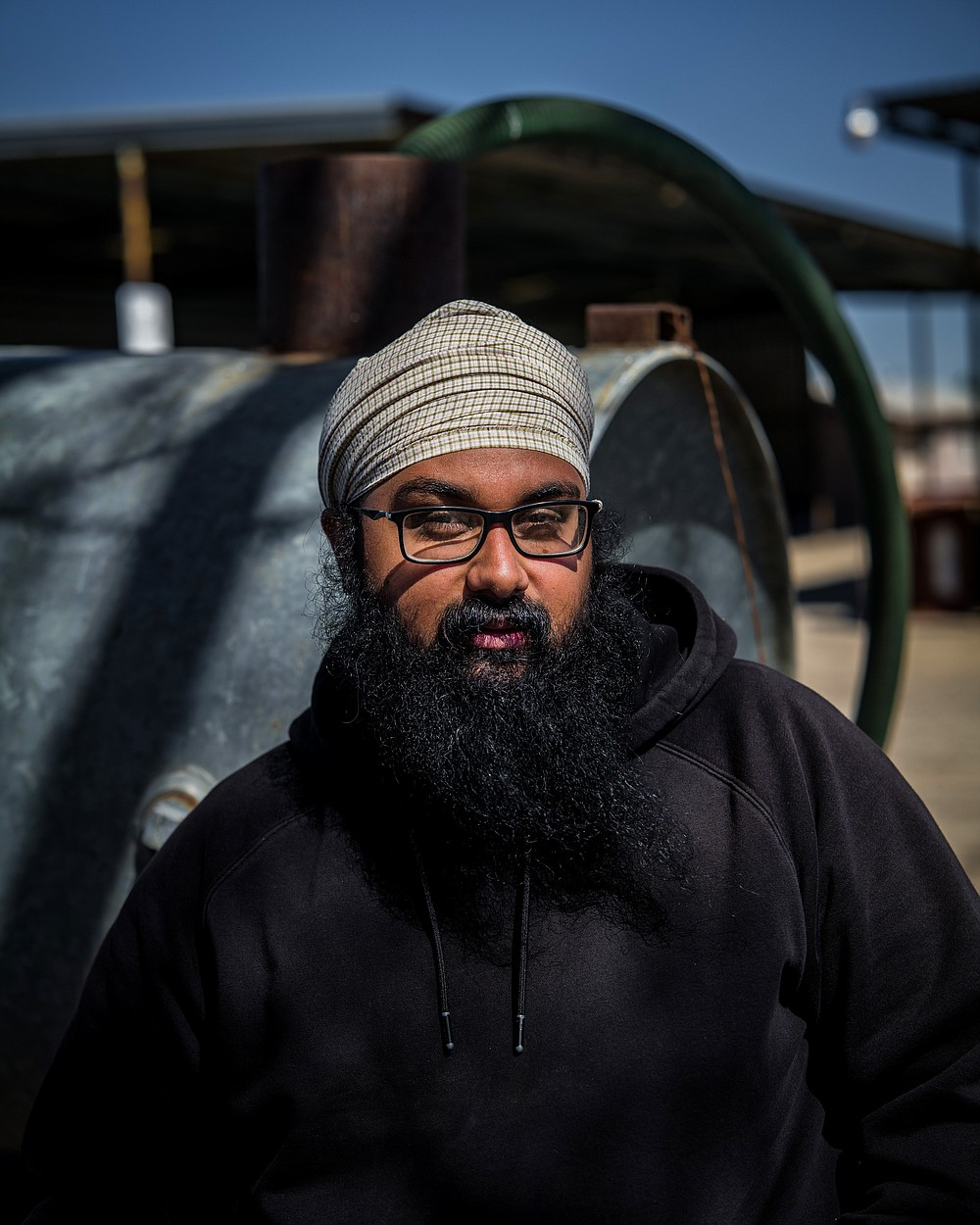 Simranjit Singh at the family farm in Kerman, Calif. where his family grows a raisins and almonds, March 23, 2021. In California, a young generation of Sikh farmers has agricultural roots that stretch back 900 years. (Ryan Christopher Jones/The New York Times)