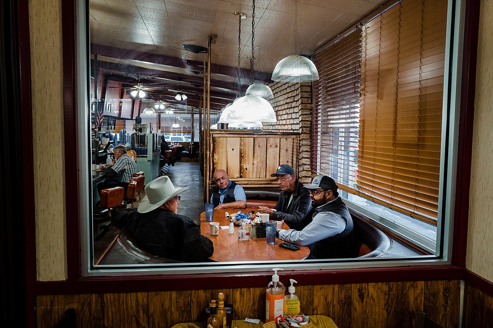 From left to right: Ron Poindexter, Allan Mohammadi, Ron Kazarian, and Simon Sihota at McCoy's Coffee Shop in Selma, Calif., March 29, 2021. In California, a young generation of Sikh farmers has agricultural roots that stretch back 900 years. (Ryan Christopher Jones/The New York Times)
