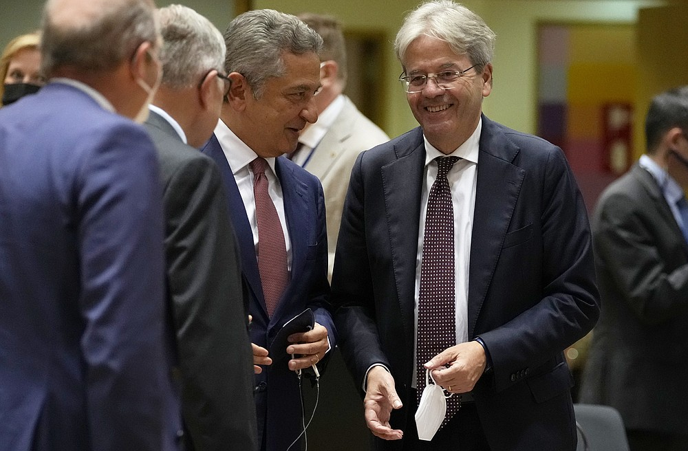 European Economic Commissioner Paolo Gentiloni, second from right, speaks with Fabio Panetta, member of the ECB's executive board, third from left, during a meeting of Eurogroup finance ministers at the European Council building in Brussels on Monday July 12, 2021 (AP Photo / Virginia Mayo)